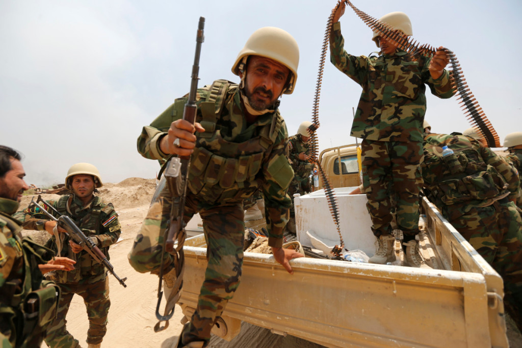 Fighters from Iraqi Shiite group Kataib Sayyid al-Shuhada gather near Falluja