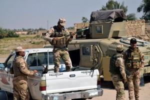 Iraki katonák a város határában Forrás: MTI/EPA/Navrasz Amer